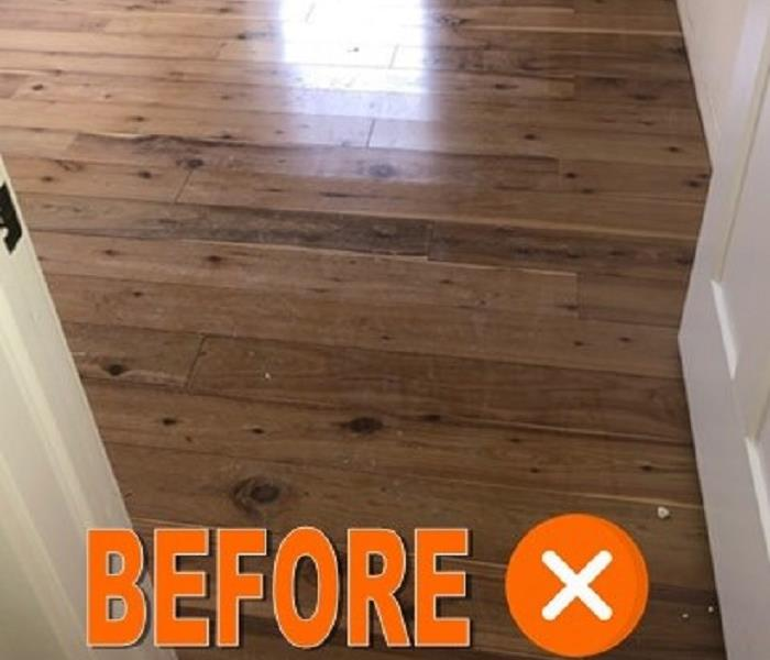 Wood flooring which has been affected by water is cupping.