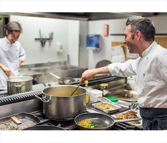 Two men working in a restaurant kitchen