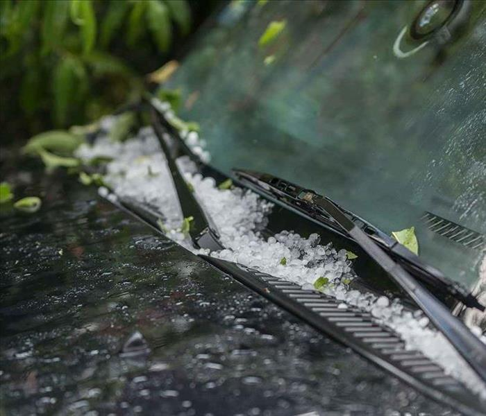 Hail collecting on the windshield of a car